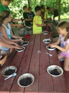 At the YMCA Junior Ranger Camp, campers get to make Seed Bombs