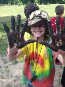 One of our junior rangers showing off her dirty hands after making seed bombs