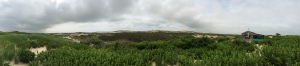 A panoramic view of the dunes in Truro, including a dune shack.