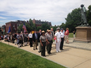 Navy and Park Service employees marched with members of the Charlestown community up to the Monument.