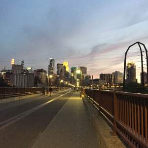 Minneapolis at dusk from the Stone Arch Bridge, one of the park's major places of interest.