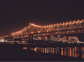 The Crescent City Connection Bridge over the City of New Orleans seen from the West Bank of The River  Photo Credit: wolvesxteeth