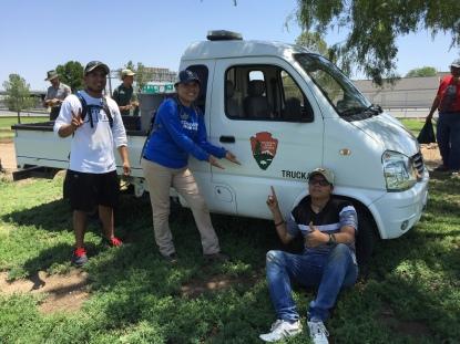 CHAM volunteers assisting  staff on turf vegetation  project