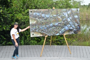 Katrina showcasing a photomosaic panel.