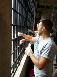 AmEx Volunteers cleaning windows of Castle Williams