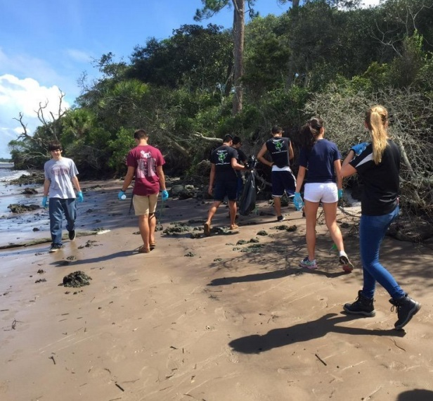 Volunteers participate in a beach clean-up at Kingsley Plantation for National Public Lands Day