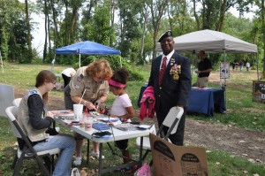 A father and hist daughter learning from local Boy Scouts