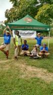 GWMP CVAs do a yoga pose during a volunteer event