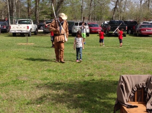 Youth Volunteer, Brett, teaching kids how to march and drill with wooden muskets